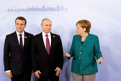 Меркель и Макрон обратились к Путину с требованием освободить моряков