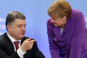 Порошенко обговорив з Меркель фінансову допомогу Донбасу