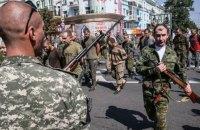 """Четырем боевикам предъявили подозрения за """"парад пленных"""" в Донецке"""