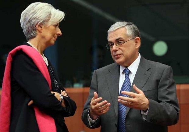 Директор МВФ Кристин Лагард со скепсисом смотрит слушает премьер-министра Греции Лукаса Пападемоса