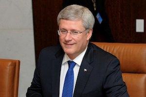 Прем'єр Канади потиснув руку Путіну з побажанням забратися з України
