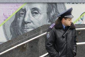 Офіційний курс долара знизився до 12,39 грн