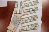 В квартире одного из руководителей центра ВНО обнаружили $134 тыс., €3 тыс. и 80 тыс. грн
