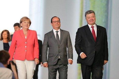 У Берліні пройшла зустріч Меркель, Олланда і Порошенка