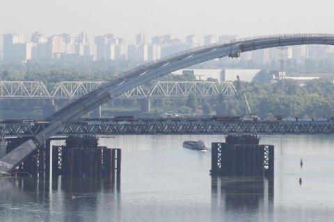Поліція провела 17 обшуків у справі про розкрадання коштів на будівництві Подільського моста
