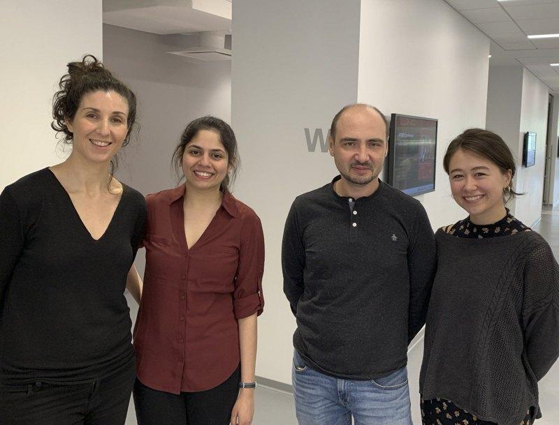 Ілля Кругліков в колі колег в The New York Stem Cell Foundation