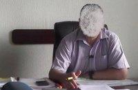 Голові РДА Київської області повідомлено про підозру у незаконній передачі в оренду 50 га землі