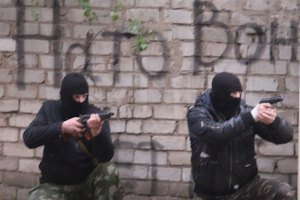 """Росія наполегливо називає збройних сепаратистів """"мирними жителями"""""""