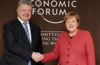 Порошенко в Давосе провел встречу с Меркель (обновлено)