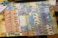 На Київщині затримали фальшивомонетників, які хотіли збути підробки на 20 млн грн