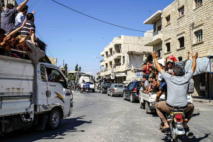 Акция протеста против возможной операции режима Башара Асада и его союзников, в городе Кафр Набл, провинция Идлиб, 14 сентября 2018.