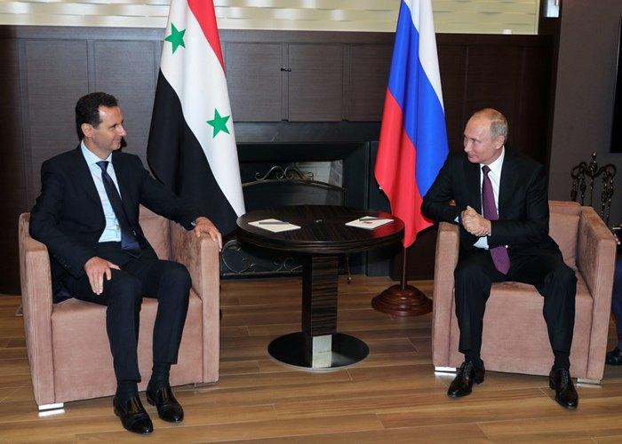 Путин и Асад во время встречи в Сочи, 17 мая 2018.