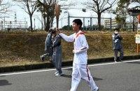 Во второй день эстафеты в Японии факел олимпийского огня снова погас