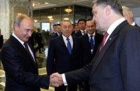 Путин заявил, что договорился с Порошенко о гуманитарной помощи