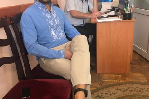 Ankle monitor put on MP Polyakov
