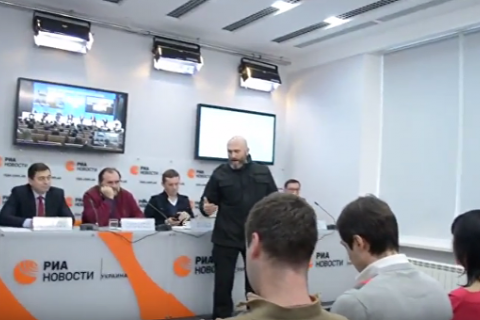 "Russian news agency says ""radicals"" disrupt Kyiv event"