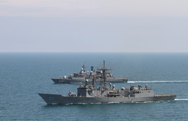 USS Taylor missile frigate and Turkish TCG Turgutries frigate during a joint exercise in the Black Sea on 11 May 2014