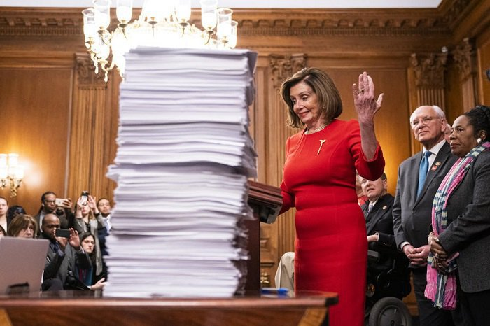 House of Representatives Speaker Nancy Pelosi with text of USMCA agreement