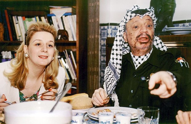 Yasser Arafat and his wife Suha during a family dinner in their Tunisian house, 1993
