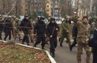 Camouflaged men crash office of former Odesa customs chief