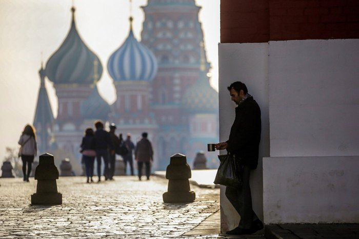 A beggar in front of St Basil's Cathedral on Moscow's Red Square, 16 October 2018.