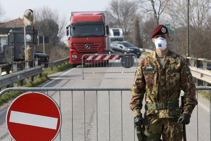 An Italian army officer at a checkpoint at the entrance to Padua, Northern Italy, 24 February 2020.