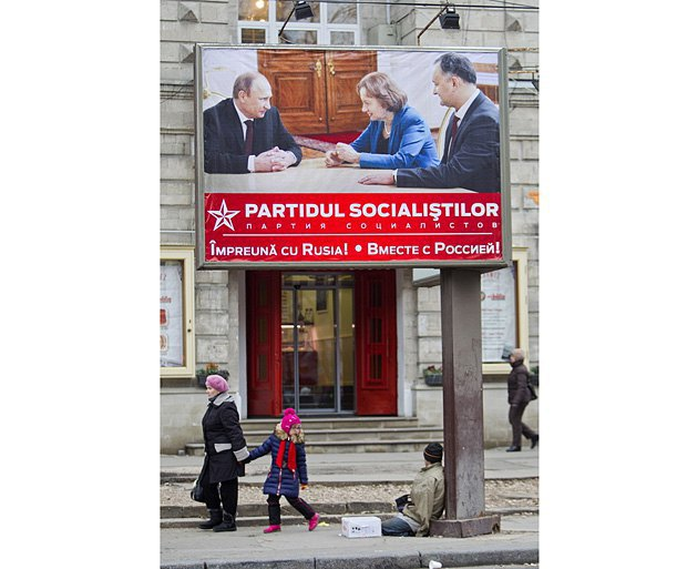 An election poster of the Party of Socialists of the Republic of Moldova (PSRM): Putin and party leader Igor Dodon (right), Chisinau, 2014