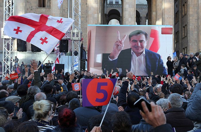 Former Georgian President Mikheil Saakashvili speaks in support of Grigol Vashadze during a video address to a rally in Tbilisi on 2 December 2018
