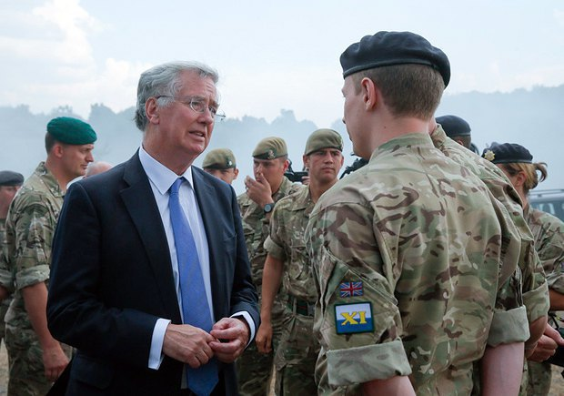UK Secretary of State for Defence Michael Fallon talking to British instructors after a training for Ukrainian servicemen at a firing range near Zhytomyr, 2015