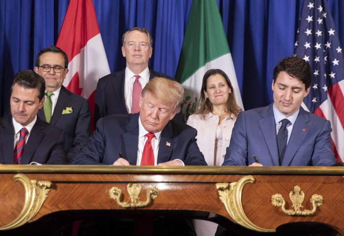 The leaders of Mexico, the USA and Canada sign USMCA in November 2018