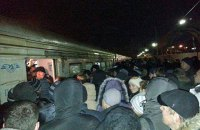Angered commuters block railway tracks