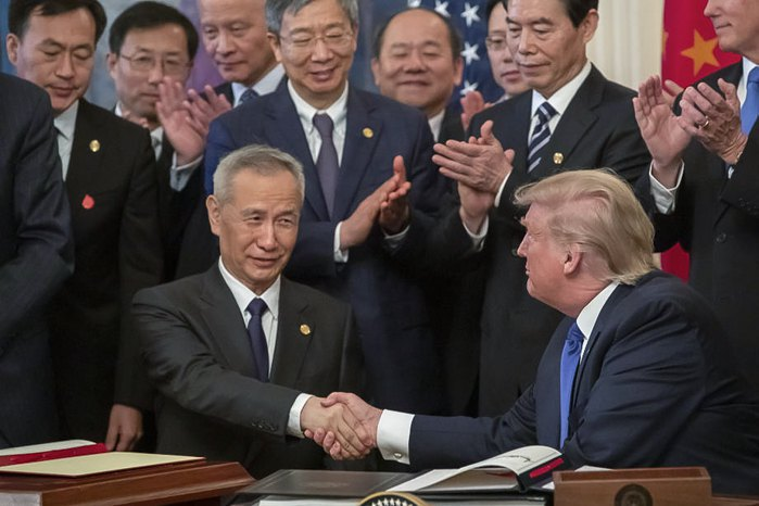 "Chinese Vice Premier Liu He and U.S. President Donald Trump shake hands during a signing ceremony for ""phase one"" of the U.S.-China trade agreement in the East Room of the White House, 15 January 2020"
