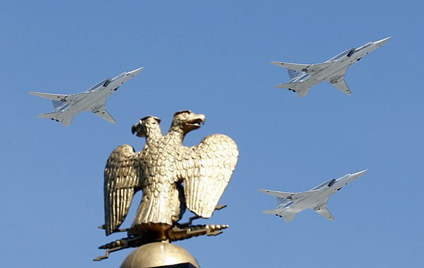 Attack aircraft flying above the Kremlin during a parade rehearsal.