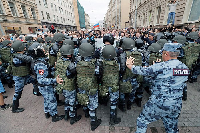 The Russian Guard blocks a protest against a planned increase in the retirement age, St Petersburg, 9 September 2018