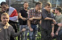 Belarusian Donbas fighters chain themselves to fence in Kyiv