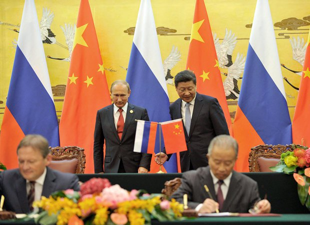 Russian President Vladimir Putin and Chinese President Xi Jinping at the signing ceremony at the Great Hall of the People in Beijing, China, 3 September 2015