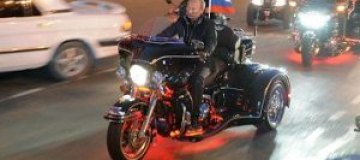 Путина оштрафуют на 500 рублей за езду без шлема?