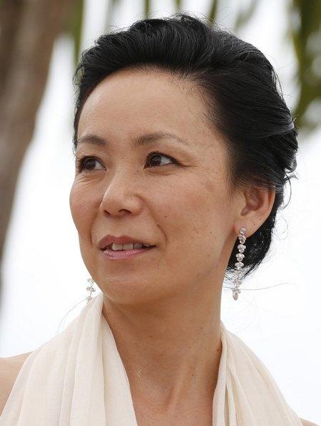 Наоми Кавасе