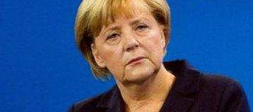 Меркель и Макрона заметили в брюссельском баре с кружками пива