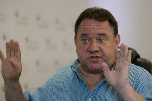 Бенюк хочет раздать депутатам по пятилитровой банке святой воды